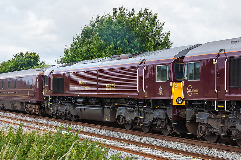 12th Jul 2016:  Royal Scotsman liveried GBRf 66743 are pictured at Fairwood as they work 1Z79.  The day's itenery started at Gloucester and went to Newton Abbot where it reversed and it is on ot's way tp Bath.  Later it will continue to Oxford via Salisbury.  66746is the leading locomoive