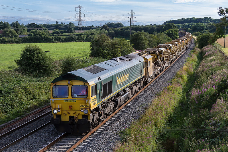 27th July 2016:  66564 is heading 6Y19 from Fairwater to Billingshurst where major ballast renewal is being undertaken.  This MOBC set will be moving to Sevington in Kent in a few weeks time so it is a case of snap it while you can.