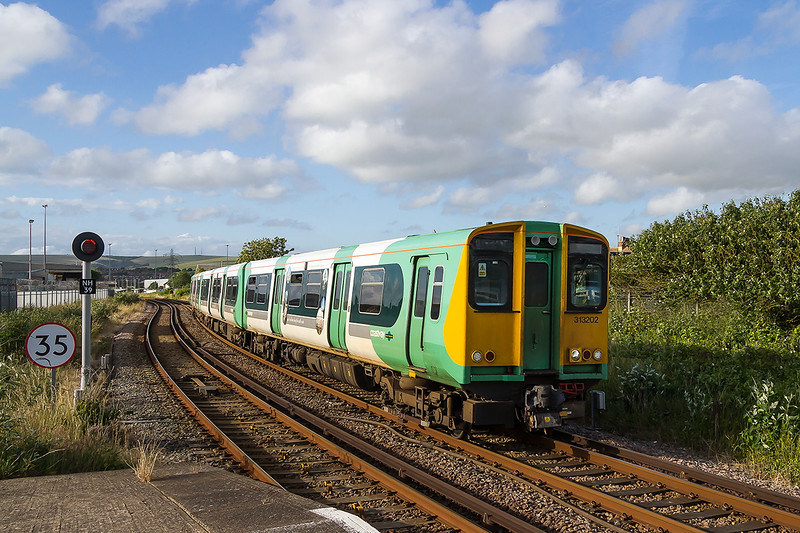 1st July 2016:  Captured arriving at Newhaven Harbour station is the 18.22 from Brighton to Seaford is 313202.  The last time a photographed at this spot the Starter was a semaphore out on a brachet roughlt where the end of the train is.