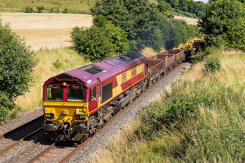 18th July 2016:  On the hottest day of the year the driver cools his hand a he brings Pallendrommic Shed 66066 though Norton Bavant as it works 6V41 back to Westbury from Eastleigh