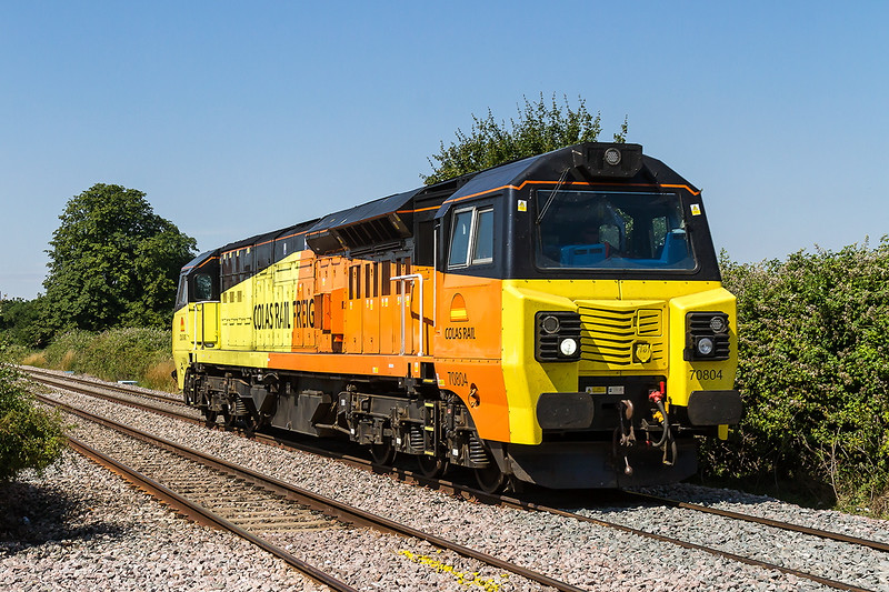 20th Jul 2016:  70804 is pictured ar Edington & Bratton good yard as it works 0O00 from Westbury to Newbury doing a  Fugro RILA track Survey.  Perfect Light  but the gear is on the back and there is no going away shot from where I was standing.  Next time perhaps !!