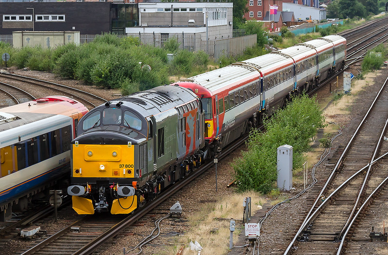 7th Jul 2016:  Not ecactly the planned shot at Eastleigh, which was supposed to be from the other side of the train, but better than nothing.  37800 working 5Q42 from Three Bridges to Eastleigh Arlington towing 442423 was held at signals.  So was the Class 444  and both trains got the green at almost the same time which caused trhe attendant gallery  to make a swift move along the bridge for the rescue shot.