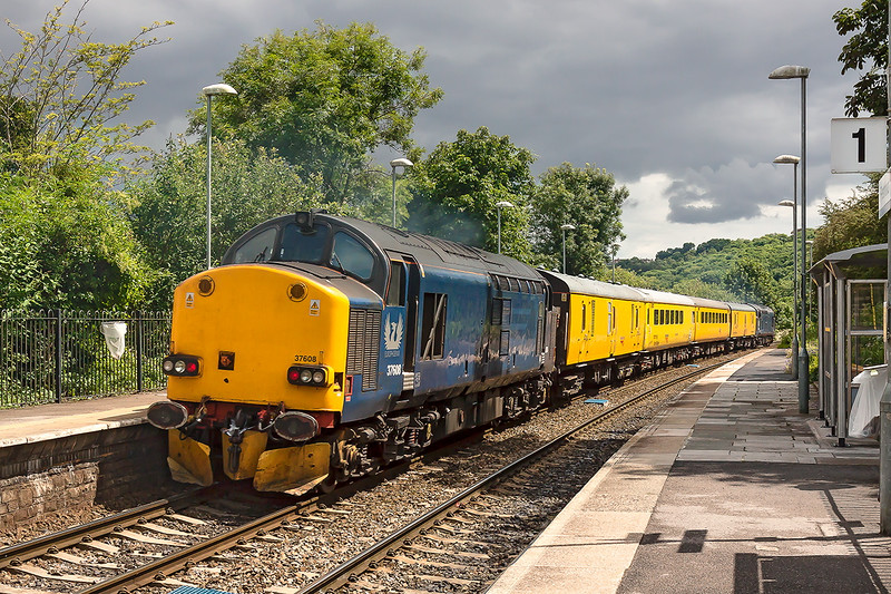 13th Jul 2016:  Part of the iitnary for 1Z79 which started from Tyseley LMD and ended at Bristol Temple Meads  was to go the Heywood Road Junction at Westbury.  Rail Operating Group loco 37608 on the tail of tlhe test train is captured at Freshford in a very fortunate patch of sun.