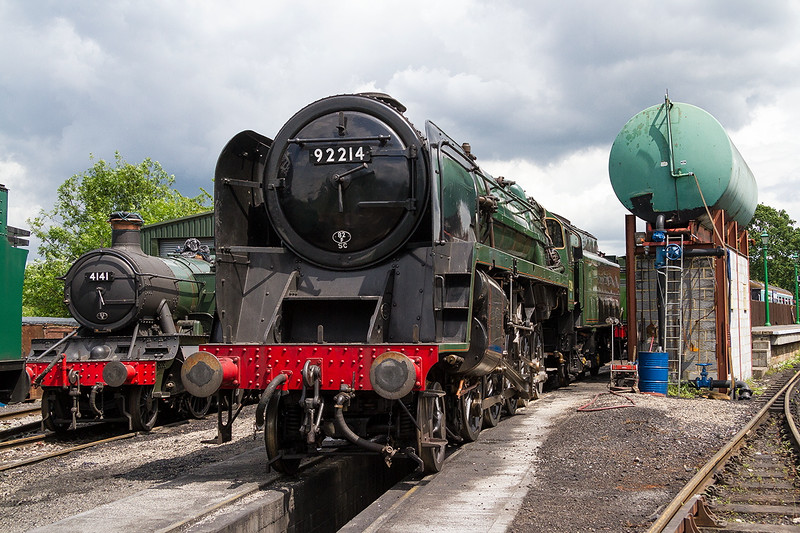 15th Jun 2016:  BR Standard 2-10-0 92214 normally resident on the Great Central Railway where it has recently been repainted into BR green liivry.  92220 'Evening Star' the last steem loco to be built in this country, was the only 9F to have recieved this scheme in BR days .  Pictured in the yard at North Weald on the Epping to Ongar Railrway in Essex where it is staying for a few months this summer