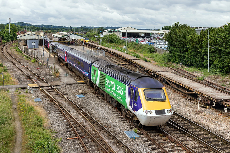 26th Jun 2016:  Running through Westbury on the rear of3Z30 the 08.45 Paddington to Castle Cary is 43126.  This was the first poer car to be wrapped  with the Bristol 2015 branding.  4 cars were done like this though the others did not have the white front.