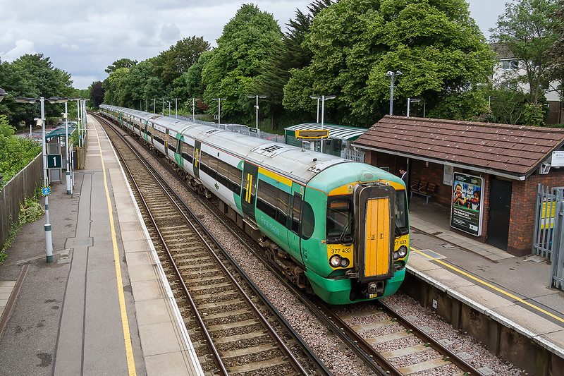 16the Jun 2016:  Running 10 minutes late as it stops at Sanderstead are 344433+377470 forming 2L26 the 11.53 Victoria to East Griinstead