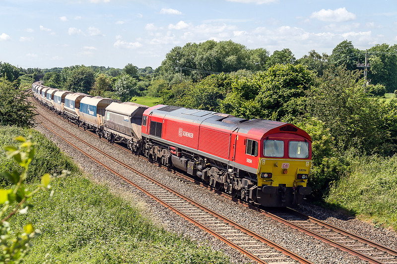 27th Jun 2016:  59204 is working hard  as it tackeles the long climb up through Lavington with L31 from Whatley Quarry to Dagenham Dock RMC.  I counted 44 waggons so including the loco it is 4500 tons