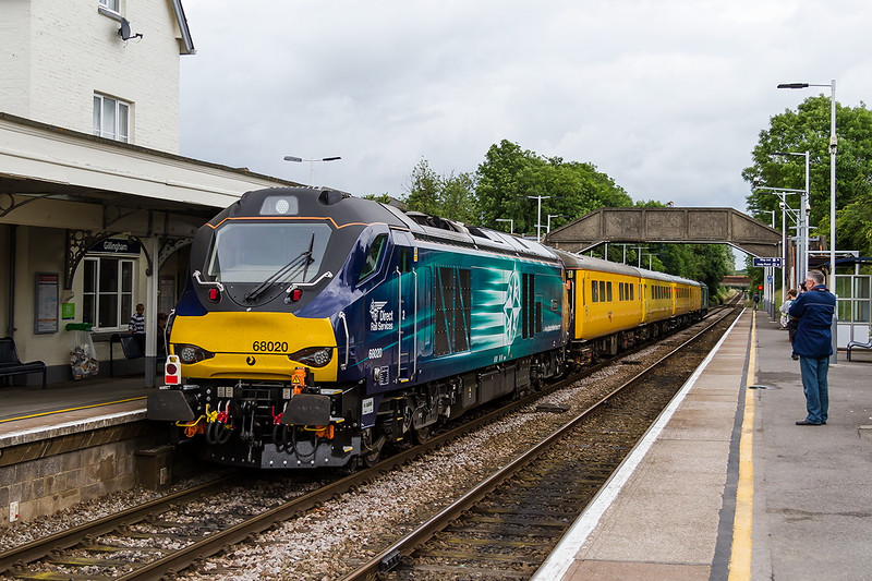 30th Jun 2016:  68020 Reliance  bringing up the rear of 1Q23 is standing at Gillingham as it waits for a Waterloo to Exeter service to clear the section ahead