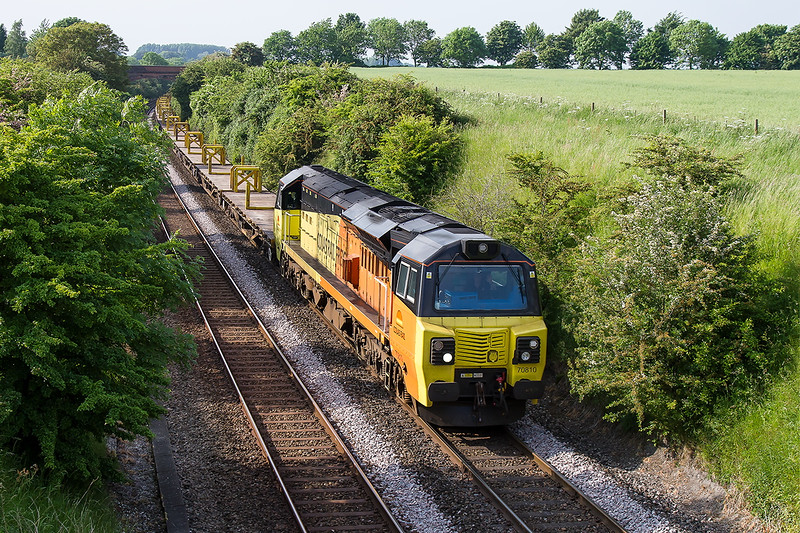 7th Jun 2016:  My  first visit of the year to this bridge at the top of the bank at Upton Scudamore was to picture the evening Colas departmental trip to Eastleigh from Westbury.  70810 is just about visible  amongst the trees.  I rather wish I had stayed on the bridge in the distance.