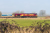 11th Mar 2016: With the early morning mist clearing the 09.22 Whatley to Theale is runnung 51 minutes late, in the hands of 66047, as it nears the foot crossing at Fairwood