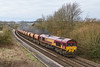 10th Mar 2016:  Had the sun been iout this might have been a contender for shot of the month.  A rare event being a  good rake of loaded PGA hoppers behind 66134 forming 7O40  Westbury to Eastleigh Agregate Sidings at Sherrington