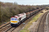 10th Mar 2016:  Nearing Fairwood Junction os 6721 'Harry Beck' at the head of 6V42 from Wellingborough to Whatley.  On a crap day a white loco certainly stands out. The top of a track side box has been cloned out