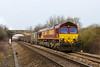 23rd Mar 2016:  The last of the EWS sheds 66250 is today entrusted with working 6C48 from Appleford to Whatley quarry.  The Church Road in Heywood bridge is in the back gound.