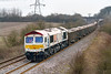 11th Mar 2016:  Picking up speed at Berkley Marsh afer joining the main line at Clink Road Junction is 66721 heading back to Wellingborough with a load of gravel from Whatley Quarry