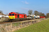 22nd Mar 2016:  Earning it's keep again is 60039 'Dove Holes' as it brings a Kirow Crane and a rake of the new bogie 'Lobsters' back from Eastleigh to Westbury.  7O41 is pictured as it runs through Wylye at Towns End Crossing