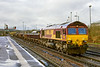27th Mar 2016:  On a cold mixed weather day 66012 shunts a  rake loaded with ballast  to be taken out  later as 6W14 to Rumney River Bridge