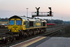 17th Mar 2016:  66597 is pictured passing through platform 1 Westbury as it hauls 4O25 from Bristol Freight Liner Terminal to Southampton Maritime.  If this train runs it is uasuallt all empty wagon but today there were 2 containers on one of the flats towards the rear of the train.  More iso 3200