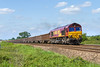 26th May 2016:  66207  is hauling 6C48 the 13.30 from Apleford to Whatley passed the foot crossing by the White Horse Business Park near Trowbridge