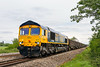19th May 2016:  Pulling away from Fairwood Junction 66714 'Cromer Lifeboat' is on the point of 6V42 the 08.15 from Wellingborough to Whatley.  Unfortunately the clouds had thickened enough by now to block the sun.