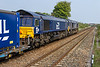 7th May 2016:  A completely buggered shot of the Daventry to Mossend Tesco Express  running up the hill through Thurnscoe.  4S43 is powered by 66423 & 66427
