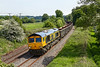 27th May 2016:  The Wellingborough to Whatley Quarry empties in the hands of 66714 'Cromer Lifeboat' sweeps down the curve through Lavington. Looking at it now it is hard to imagine that from 1944 up until 1964 there was a turnout on the left that led into the Up Good Loop.