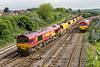 22nd May 2016:  Passing 59202 as it arrives at Westbury is 66051 with 2 sets of Auto Ballasters.  6W33 has started fron Swindon