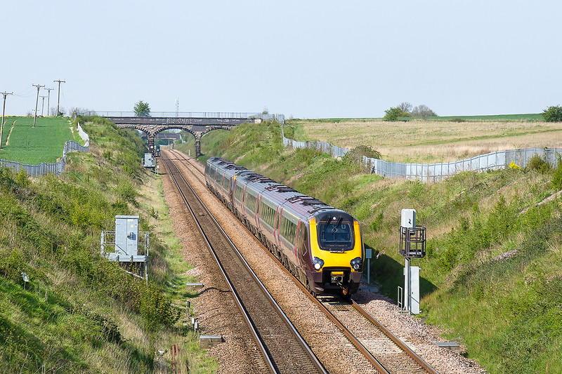 8th May 2016:  1V64 is the 12.00 from Glasgow Central to Plymouth. formed of 2 Voyagers  it is captured  at the start of the grade down through Thurnscoe.  For an unknown reason the train was terminated at Exeter St Davids