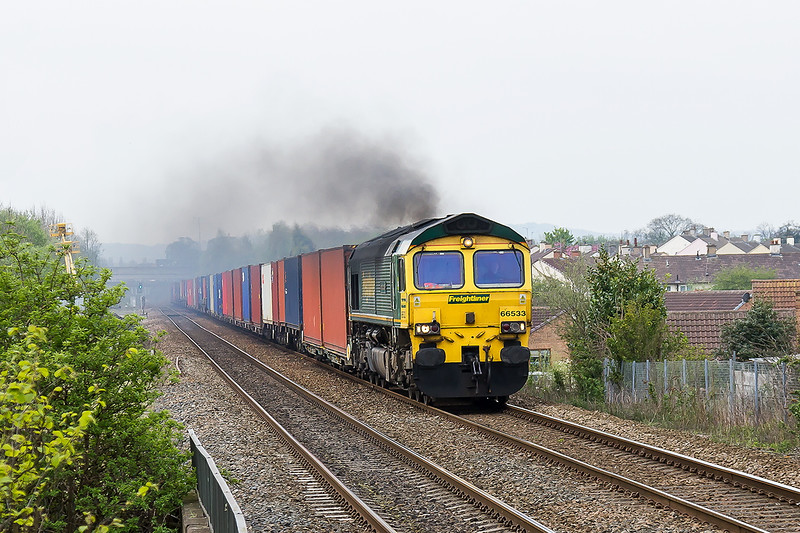 6th  May 2016:  Smoking like a kettle 66533 powers 4E01 the 03.22 Southampton Maritime to Leeds up the grade through Thurnscoe