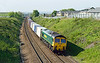 9th  May 2016:  4E01 the Mondays only  03.22 from Southampton Maritime to Leeds powered  by 66502 is captured on the climb away from Thurnscoe with only a few miles of it's journey left to complete