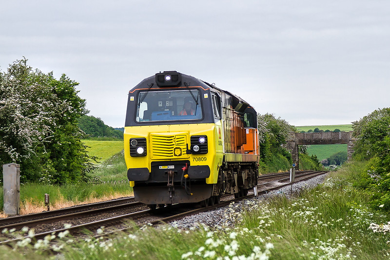31st May 2016:  Running through Bapton is  Colas Rail Freight 70809 heading for Eastleigh East Yard from Westbury.    At this time of the year at 6am the is angle of the sun will be perfect  to capture one of the morning stone services Mmmmmm!
