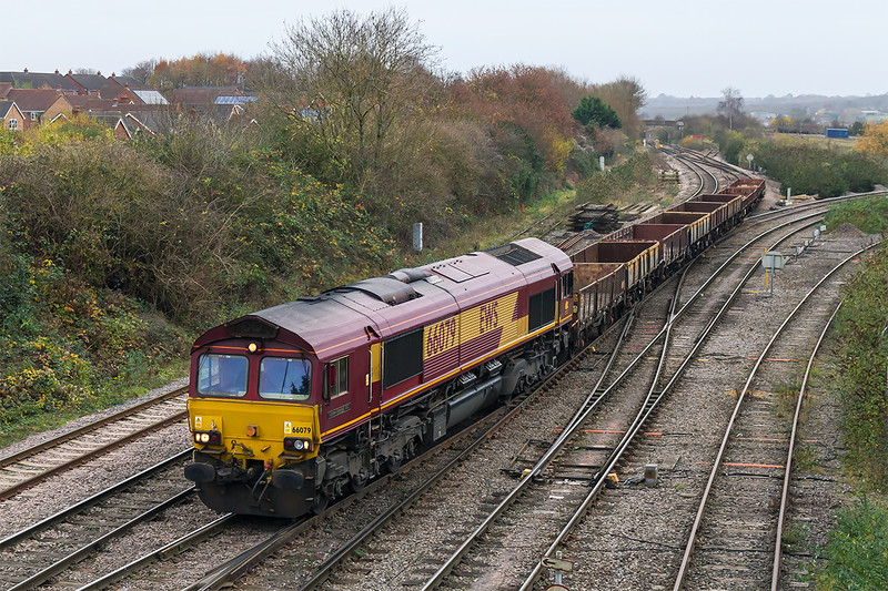 27th Nov 2016:  In dingy conditions 66079 'James Nightall GC' arrives back at Westbury with an interesting set of empty wagons from Ebbw Junction,  I have no idea what the working code was unfortunately