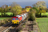 9th Nov 2016:  Running into the good light passed Baynton Farm in Edington is 59205 on the point of 6C31 from Theale to Merehead
