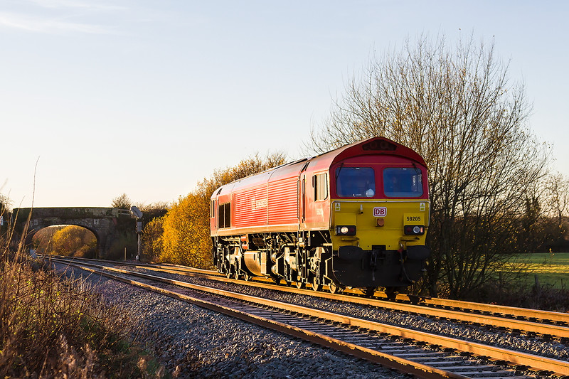 28th Nov 2016:  In incredible afternoon light at Fairwood 59205 works back to Westbury from Whatley Quarry