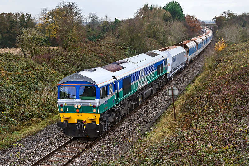 23rd Nov 2016:  24 minutes after the Stad Farm had passed 59004 'Philip J Hammond' trundles passed at the helm of 6B12 from Merehread to Wootton Bassett
