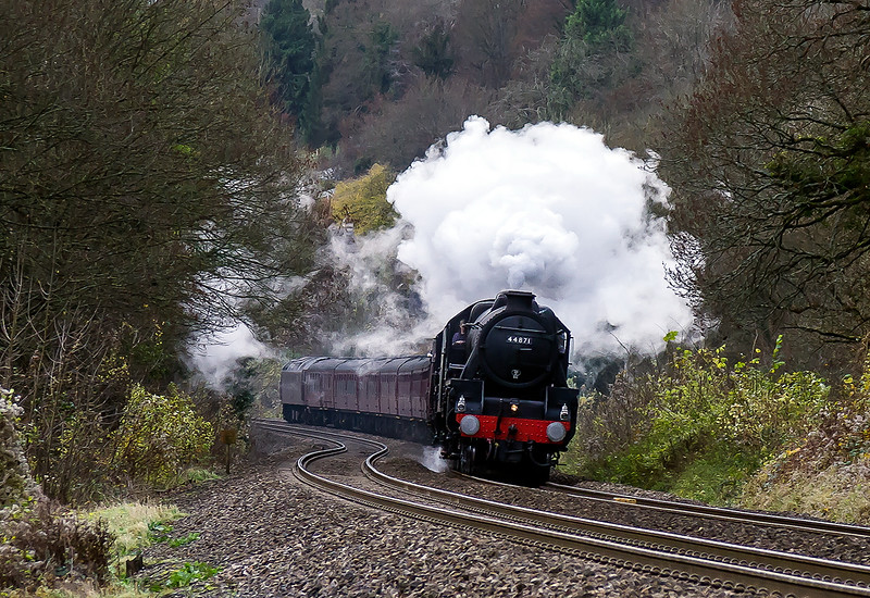 24th Nov 2016: Running from Poole to Bath to enable passengers to Visit the Bath Christmas Market is 1Z87 powered by LMS Black 5s 44871 & 45407 .  The picture is taken from Fishers Crossing just north of the site of Limpley Stoke station.  The grass verge behind the locos originally  sported a 3rd line that was about to vere away to the left and head for Camerton. Its's last use was for making the film 'The Titfield Thunderbolt'.  47802 can be seen on he rear