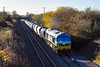 28th Nov 2016:  59004 is in charge of 6L42 from Whatley Quarry to Dagenham Dock passing Lambourne Lane in Edington