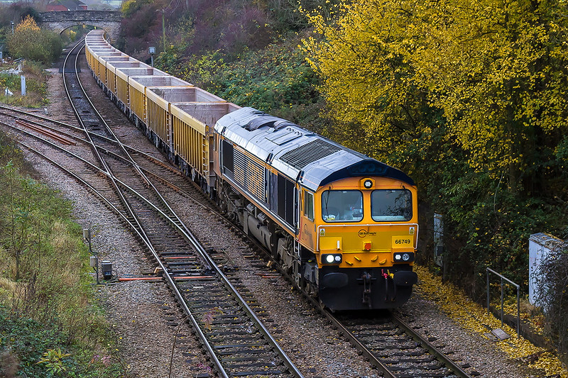 16th Nov 2016:  Pictured at Hawkeridge Junction as it crosses the connection to the East Chord that was opened in July 1942 is 66749.  The empty boxes are the load of 6M40 that runs from Westbury to Stud Farm to clollect ballast to top up the virtual quarry