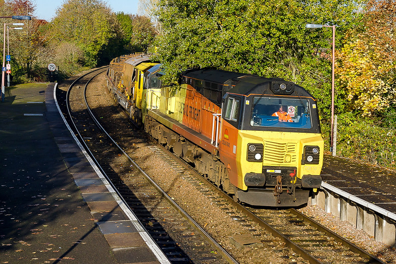 7th Nov2016:  Loppers neaded at Warminster !!  70810 is in charge of 6C98 the 04.52 from Plymouth to Easteligh passing through the over growth at Warminster station.