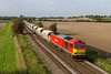14th Oct 2016;  Having just breasted the hill from Westbury to Upton Scudamore 60091 'Barry Needham' and 7O40 from Merehead to Eastleigh starts ot accelerate.  The location is Granada Bridge on the Warminster Bye Pass