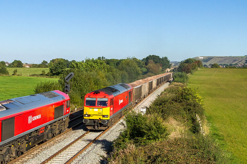 5th Sep 2016:  59203 waits for the road as 60091 works 7V16 empties from Fareham to Whatley towards Fairwood Junction