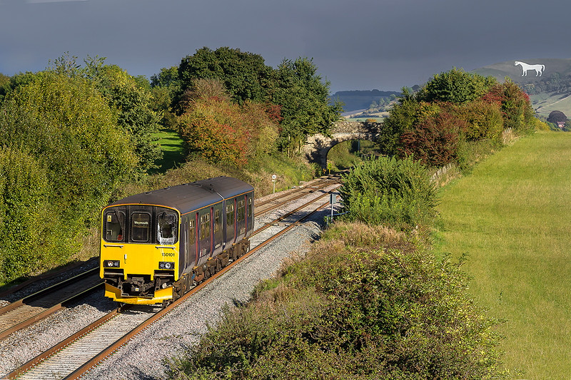 12th Oct 2016:  Late afternoon is a good time to picture all the empty stone trains returning to the quarries but today the sun did not play ball.  150101 is working 2O90 the 12.51 from Great Malvern to Weymouth and catches the sun at Fairwood.  Better than nothing though.