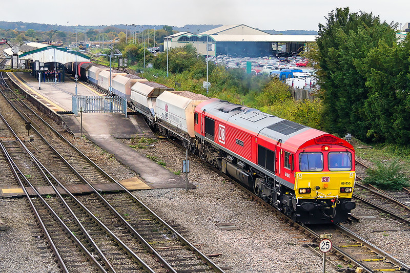 28th Oct 2016:  The recently rebranded with the large DB logo 66055 leaves Westbury working 6M20 from Whatley Quarry to St Pancras Churchyard Sidings. Now named 'Alain Thauvette' it is good to see a propper name plate in the right place  IMHO.   Fortunatley it was about 3 minutes late leaving as had it been on time I should have missed it.  Phew some times you do win.