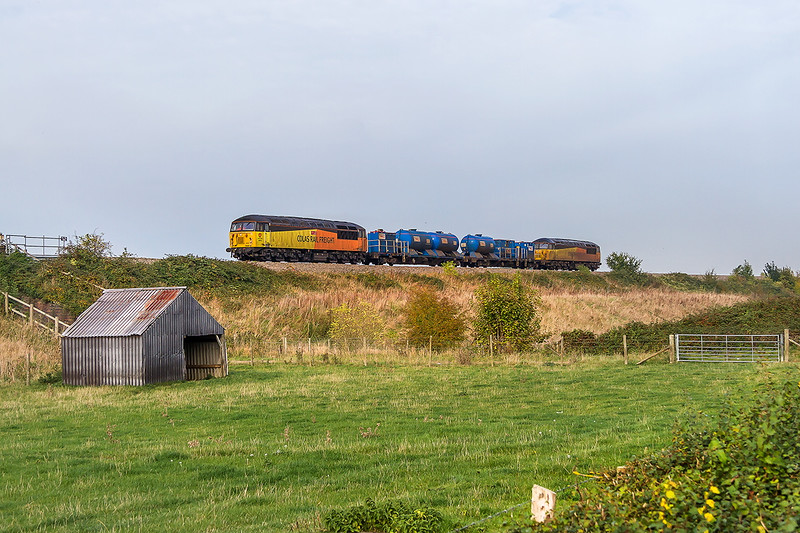 21st Oct 2016:  Now running  about 100 minutes early it was not possible to get to the planned location to picture 57302 and 56087 on 3S33 from Swindon to Gloucester.   So this roadside location between Eckington and Bredon was the best that could be managed.  Better than nothing I suppose