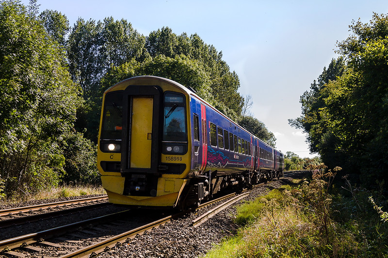 5th Oct 2016:  It is hard to imagine that 60 years ago this view would have been blocked by a signal box !.  158959 is forming 1V94 the 08.59 Bighton to Great Malvern service past Sherrington Lane in the Wylye Valley