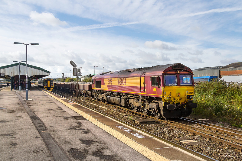 18th Oct 2016:  66004 with a long rake of loaded ballast wagons getting underway for Severn Tunnel Junction via Gloucester with 66126 on the other end,  Track relaying through the tunnel being the reason for 6W57 being run