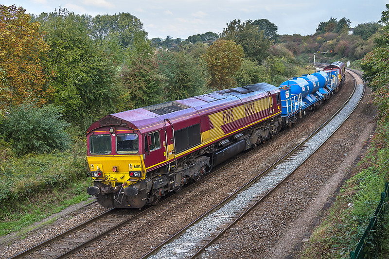 13th Oct 2016:  Frustratingly passing just after a long sunny spell 6Z11 is working from Westbury to Bristol Barton Hill.66051 in on the front and 66133 at the rear