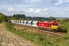 30th Sep 2016:  Grinding up the sharp climb to Upton Scudamore is 60091 and 6O40 the Fridays only Merehead to Eastleigh.  1 in 70 is not overly steep but is  attacked from a dead stand in the yard.which explains the walking pace