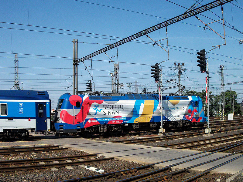 7th Sep 2016:  Szech run 20 of these Skoda built mulii voltage locos.  Here in v 'Sport uj S Nmai livery 380 002-6 leaves  Prague
