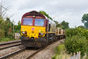 29th Sep 2016:  Working very hard up ther hill through Dilton Marsh is 66174.  6O41 the morning departmental from Westbury to Eastleigh had a good loaod including LWR and a rake of loaded MLA/MHA ballast wagons