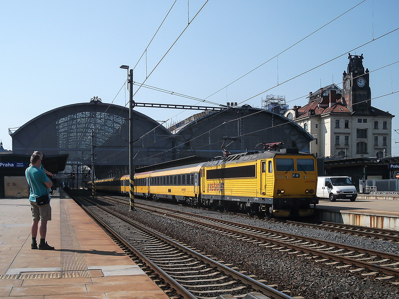 7th Sep 2016:  In the private company  Regio Jet livery 162 121-1 with matching stock waits  the RA at Prague station as a couple of enthusiasts look on